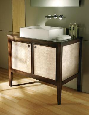 MTIWhirlpools Transitional line of bath furniture is able to complement both contemporary and traditional bath fixtures. Made with FSC-certified hardwoods, the line is low-VOC and low-HAP. ¨They are available with optional hardwood tops, and each piece is customizable from interior and exterior finishes to decorative front panels that include linen, exotic zebrawood, and antique mirror. Drawers include dovetail-joined construction, and doors and drawers feature soft-close hardware.The vanity shown includes an Aphrodite shell design from wallcovering manufacturer Maya Romanoff and a tropical veneer. mtiwhirlpools.com