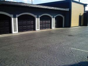 The concrete parking lot poured on one cold November day used 75 yards of dark gray integral color that was then stamped with a fan pattern.