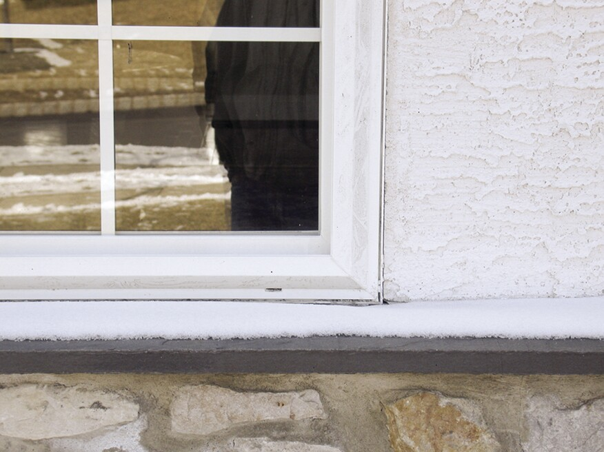 If stucco is brought tight to window and doors, it it tends to crack over time and the window  and trim expands and contracts, opening an entry point for water. Photo: Dave Haines
