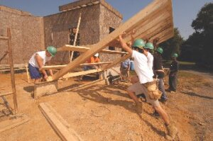 FATE students build a house in Northern Virginia. Money from FATE home sales funds the program.
