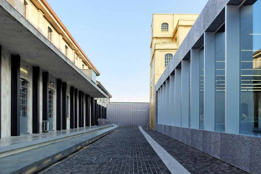A view of the forecourt and understated museum entrance at OMA's Fondazione Prada, in Milan.