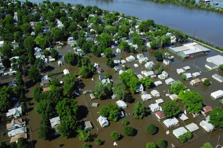 Rising tide: Cedar Rapids, Iowa, was inundated by flooding in June, but since then rebuilding has been slow.