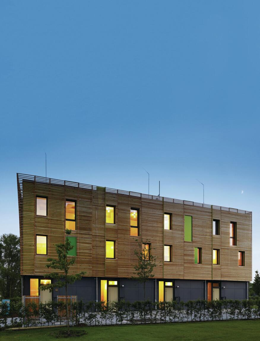 The street façade of the Soft House is clad with a larch wood rainscreen over mineral wool insulation and a water barrier.