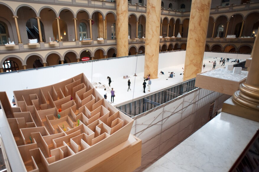 """The Beach"" from above, seen behind a model of Bjarke Ingels Group (BIG)'s ""BIG Maze""—last summer's installation at the museum."