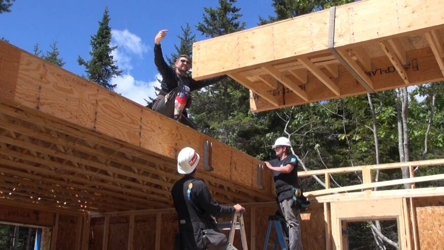 EcoCor panelized the second floor frame as well as the walls for the house. Top, the crew sets a floor panel section into place.