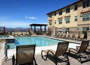 COVERING THE BASES: Riverstone Residential employs a suite of online and on-site services and technologies to run properties, including Alexan Briargate in Colorado Springs, Colo.