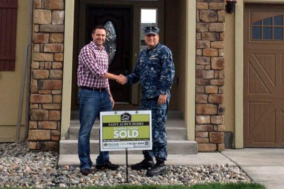 Saint Aubyn sales agent Kit Bradshaw with home buyer Lt. CommanderJose Vargas.