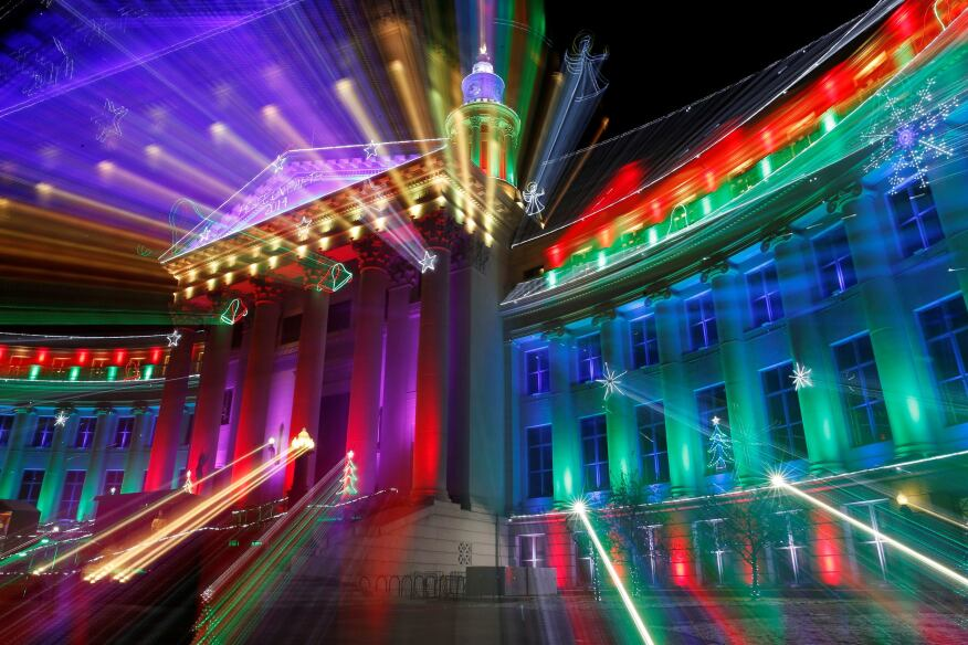In this photo taken with a slow shutter, the Denver City and County building is illuminated by the traditional holiday light display. The holiday lights will burn each evening in Denver through New Year's Eve and then resume for the annual run of the National Western Stock Show and Rodeo.