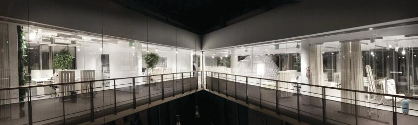 The fifth-floor atrium of the base building offers a panoramic view of the open-plan office, including the two additional bubbles that are used as conference space.