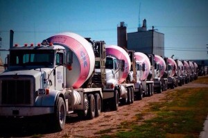 Stan and Kyle Poff of Kearney Concrete worked with local companies to paint and install Concrete Cares ribbons on each ready mix truck in Kearney's fleet.