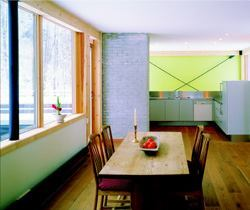 In keeping with the home's straightforward design, the architects left its steel cross-bracing and glue-laminated-beam window and door trim exposed.