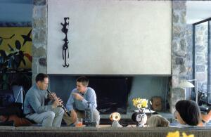 CONNECTICUT, UNITED STATES - 1963:  Architect Eliot Noyes (L) playing oboe while son Eliot Jr. gives advice in living room of house designed by Noyes.  (Photo by George Silk/Time & Life Pictures/Getty Images)
