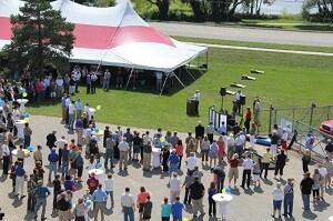 A large crowd gathered at Besser Company's World Headquarters in Alpena, Michigan, for a ceremony celebrating the Company's 110th anniversary, 60 years of training and 10 years of being an employee-owned company.
