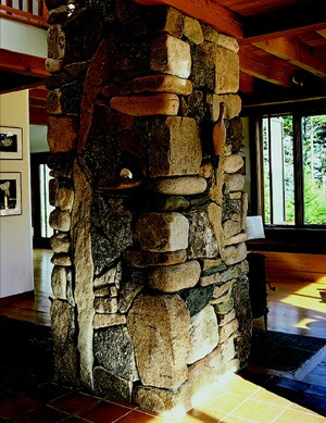 Another, more dramatic way to create a point of focus is to make an unusual piece of craftsmanship the primary attention grabber for a room, or even for the entire house.  This amazing stone chimney -- crafted by stonemason Jeff Gamelin in a house designed by architect Robert Knight on the coast of Maine -- is a wonderful example of a piece of construction that trenscends its utilitarian function and becomes perhaps the most memorable feature of the house.