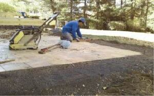 Figure 1. Patios made from concrete pavers can add space to a backyard project at a fraction of the cost of a deck.