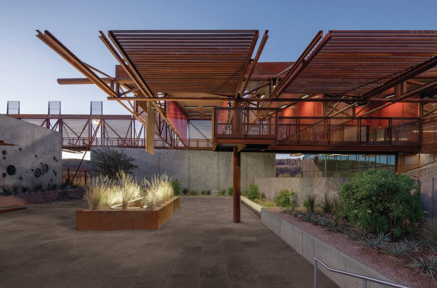 Cor-Ten canopies also shade small plazas and seating areas where post officials can gather. The landscape was designed as part of a rainwater retention system, while echoing the surrounding Sonoran desert.