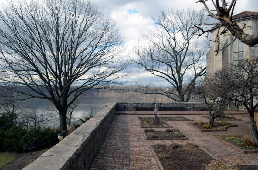 View of the Palisades and Hudson River looking west from the Bonnefont Cloister garden in New York City. (2013).