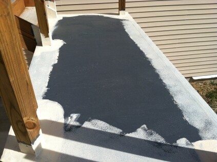 After the final coat of waterproofing cured, the author began applying the first of two coats of Safe-TDeck top coating.