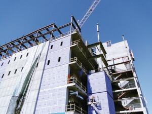 Concrete is an ideal material for increasing the energy efficiency of a building. Insulation can be placed on the outside, as shown here, in the middle, or on the inside of a concrete wall.