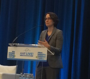 Elizabeth Kneebone, a fellow at the Metropolitan Policy Program at The Brookings Institution, addresses attendees at AHF Live: Housing Developers Forum in Arlington, Va., on May 11.