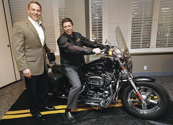 Ready To Ride:Jeff Gore, president of Galt, Calif.-based BMD, checks out his new 2013 Harley-Davidson Sportster 1200 Custom motorcycle. Gore was the winner of a new ride, courtesy of event co-sponsor Kleer Lumber. Jack Delaney, Kleer's vice president of marketing, is at left.
