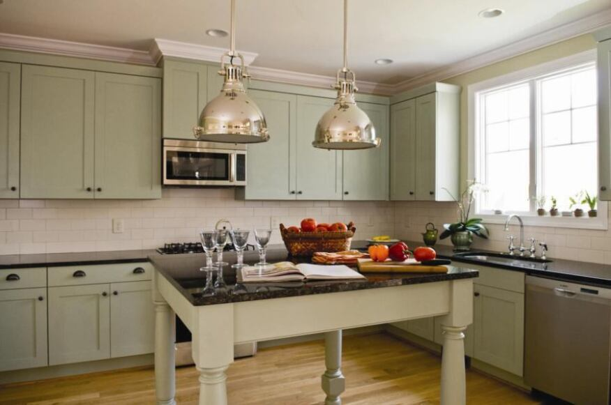 Gourmet Ingredients: Painted kitchen cabinets with European styling are a hallmark of Zinn's recent work.