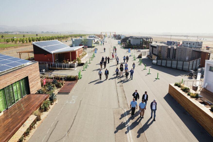 Visitors stroll down Decathlete Way.