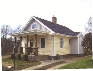 The thermal envelope of this 1930s house was upgraded with rigid insulation in the foundation, blown cellulose in the above-grade walls, insulated siding, new windows, and insulated fiberglass doors. The team then used a high-efficiency mechanical system and an energy recovery ventilator to improve indoor air quality and create a comfortable atmosphere.