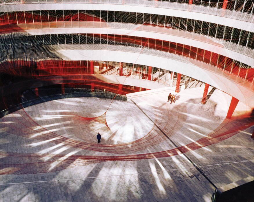 "In 2001 Echelman designed ""Target Swooping Down...Bullseye!"" The 135-foot-wide by 90-foot-tall nylon lace net was attached to the perimeter of the atrium in the Spanish National Trade Fair Complex in Madrid."