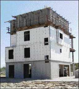 Concrete houses for the coast jlc online foundation for Footing size for 2 story house