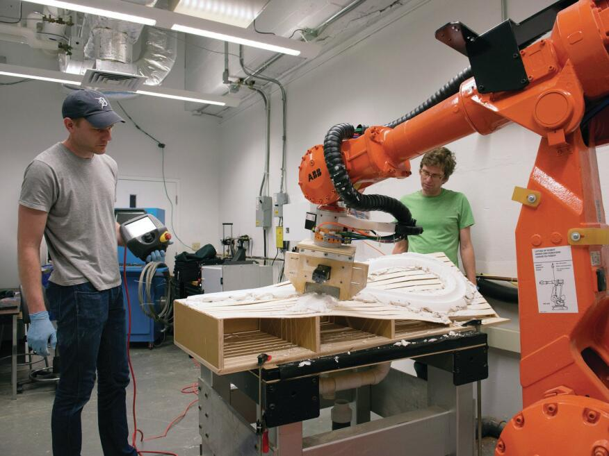 Morphfaux collaborators Joshua Bard (left) and Steven Mankouche work with a robotic arm outfitted with a variable profiler tool in the Digital Fabrication Lab at Carnegie Mellon University's School of Architecture, in Pittsburgh.