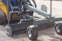 Skid steer grader blade and rock grapple