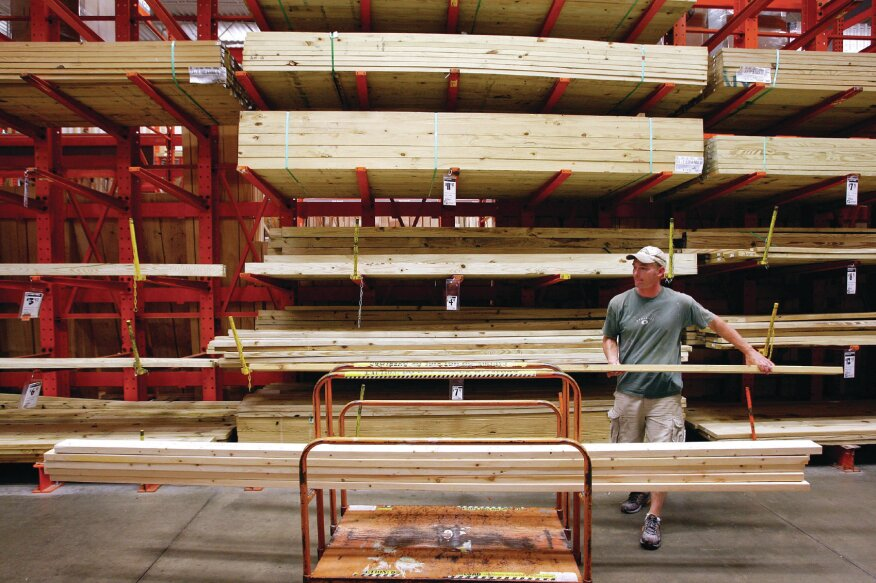 ALGONQUIN, IL - AUGUST 19: Mark Lankin loads lumber onto a cart at a Home Depot store in Algonquin, Illinois. Home Depot, the world's largest home improvement retailer, today reported higher-than-expected quarterly profit.