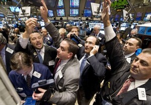 Traders crowd the post that handles Morgan Stanley on the floor of the New York Stock Exchange near the close of trading, Wednesday Sept. 17, 2008. The Dow Jones industrial average dropped about 450 points, and investors seeking the safety of hard assets and government debt sent gold, oil and short-term Treasury's soaring.  (AP Photo/Richard Drew)
