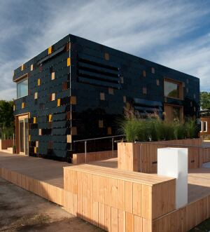 Term Germany'ssurPLUS house features 250 thin-film copper indium gallium diselenide panels enveloping its facade, providing an eye-catching architectural look while generating solar energy.