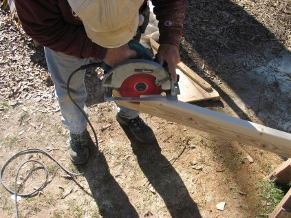 To cut the acute angle, make the cut from both sides of the plate stock. When finished cutting, smooth the cut  surface wth a belt sander. Measure and cut the plate to length by making a simple plumb cut at the top.
