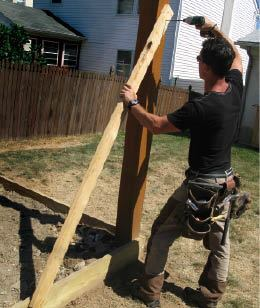 Bracing the posts to the box not only keeps them plumb, it stabilizes the assembly and makes it safer to climb on during construction.