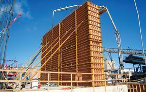 Bleigh Construction Corp. used a proprietary form system to build massive kiln pier walls for a Continental Cement Co. plant in Hannibal, Mo. Bracing supports the forms for one of the largest pier walls, which measured 46 ft. long by 32 ft. tall and 4 ft. 6 in. thick. These walls would later support a 8-ft.-thick slab.