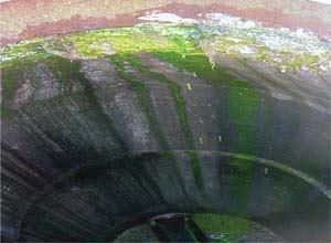 Dye water flooding consists of forcing nontoxic, brightly colored dye into manholes to assist in locating defects. Photos: R.A. Smith National