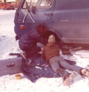 What gearhead road trip would be complete without emergency repairs?  David Frane (right) and his buddy Fast Eddie replace the king pin and spindle on Frane's '69 Chevy van in a parking lot outside of Boston. As bad as this looks it's better than the time the drive shaft fell off at 3 A.M. in a blizzard. The van is long gone but Frane still owns that tool box.