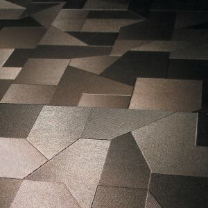 "Gres Catalan's Puzzle tiles combine geometric shapes with subtly contrasting tones and textures. Suitable for floor and wall applications; available in silver (above), black, and white.    23"" x 23"", 16 1/2"" x 23"", 4"" x 23"";  grescatalan.com"