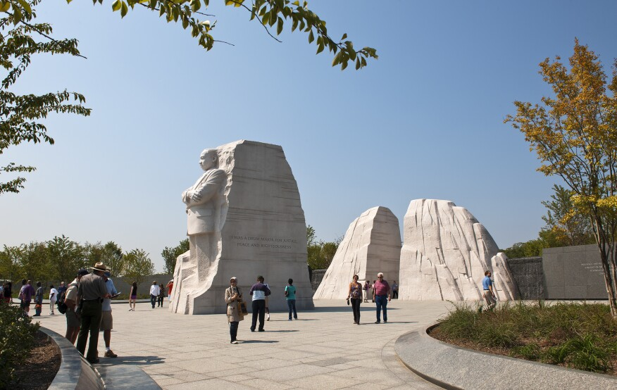 """A view of theMartin Luther King Jr. National Memorial during the day.The statue of Dr. King in the """"Mountain of Despair"""" emerges from the """"Stone of Hope"""" in the background."""
