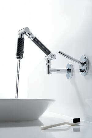 Kohler.    The companys Karbon industrial-style articulating faucet is now available in a smaller profile for baths. The WaterSense-certified units come in deck-mount, wall-mount, and wide-spread options in silver or black with polished chrome or brushed nickel accents. They feature two spray options. 800.456.4537. www.kohler.com.