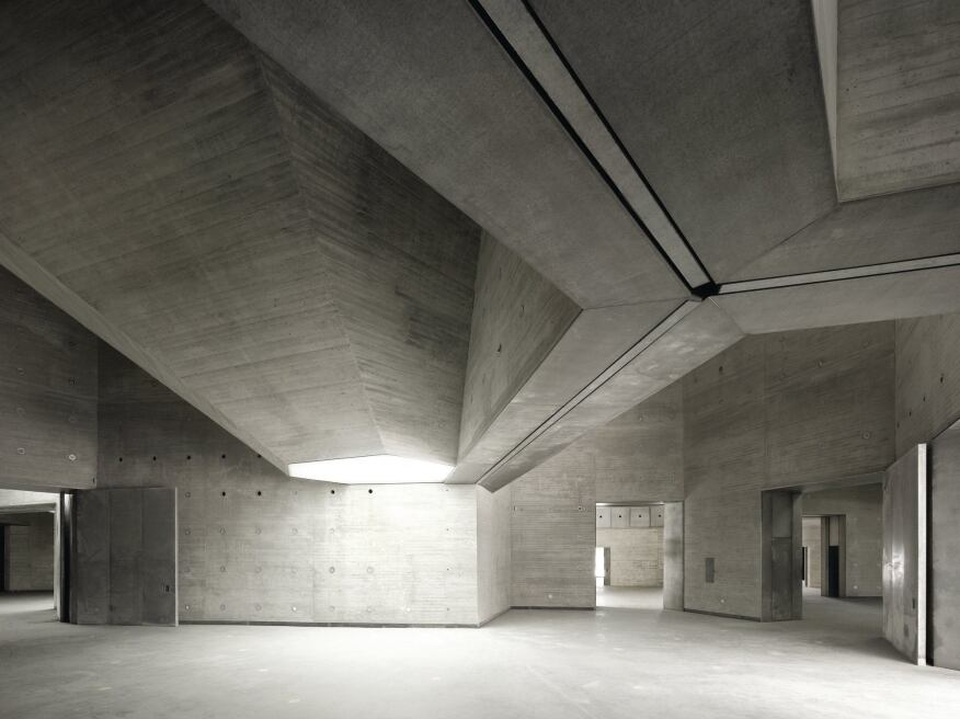 The series of hexagons comprising the roof plan informs the 18 faceted, cast-concrete light shafts that spring above or cleave through the Contemporary Art Center's ceiling. Workers used wooden forms to cast the concrete in place.