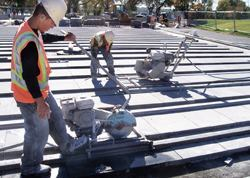Using a walk-behind saw on a set of rails, workers could guide the saw to a perfect cut.