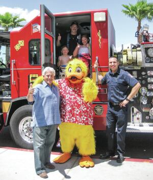 Joe Vassallo, Paragon Pools' president, and Duckie, the Float Like A Duck mascot, invite families to join them for the 10th Annual Paragon Pools water safety event.