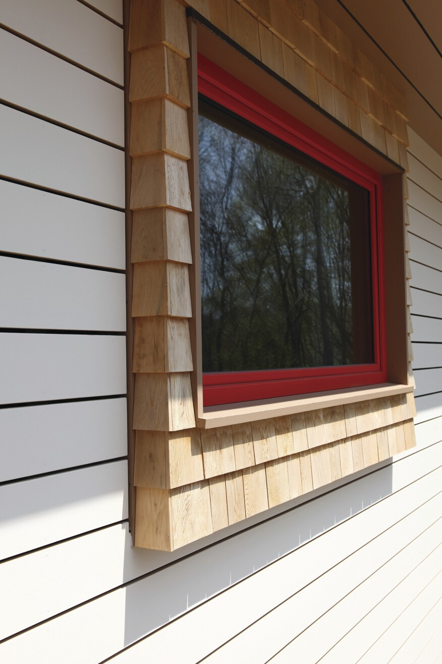 Transitions between the two types of siding have to be carefully detailed to channel water away from both surfaces.
