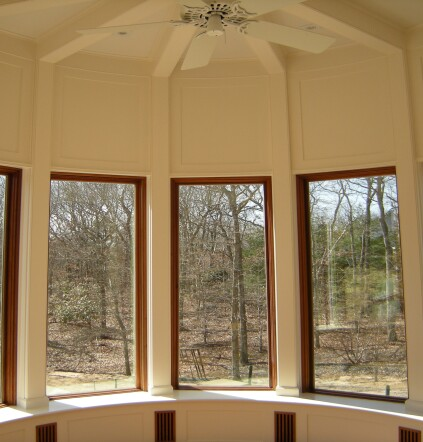 The first-floor breakfast room was trimmed with curved paint-grade paneling. The plywood fit into a rabbet formed between the laminations in the stiles and rails.