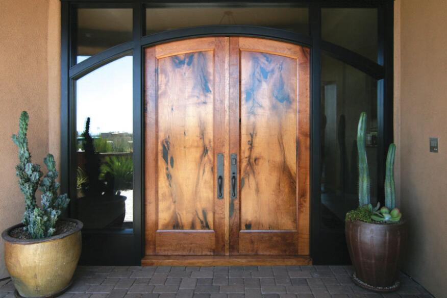 Dramatic Entry: A custom mesquite door made by door and furniture maker Wayne Hausknecht is set in a glass surround. Remodeler Janice Donald found Hausknecht through a referral. She is always networking in the community to find local artisans to work with.