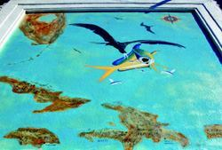 Ed Moran's work features overlay cements to portray thematic scenes of Caribbean maps and fish and waterfowl.